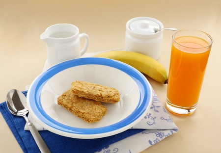 Iconic Australian breakfast cereal Weet Bix served with juice and milk. photo