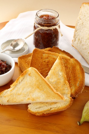 Jar of homemade fig jam with a toast slices of crusty bread. Stock Photo - 9076025