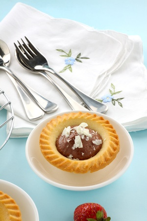 chocolate tart: Delicious single chocolate tart in a dish ready to serve. Stock Photo