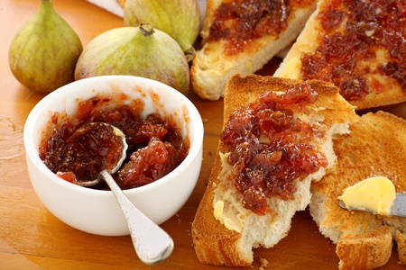 Rustic homemade fig jam sandwiches on toast ready to serve. photo