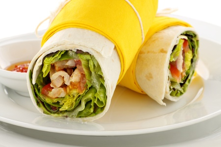 Delicious spicy chicken wraps in tortillas ready to serve.