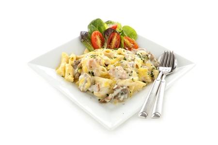 Delicious creamy chicken penne pasta with a garden salad. photo