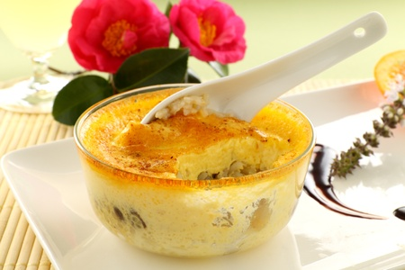 custard flavor: Fresh baked rice custard with a spoon straight from the oven ready to serve. Stock Photo
