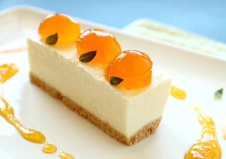 cake ball: Delicious mandarin cheese cake with mandarin balls and a fruit sauce.