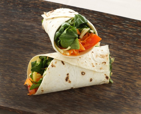 Freshly prepared vegetarian wraps with healthy salad ready to serve. Stock Photo
