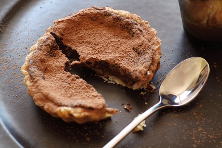 chocolate tart: Delicious fresh baked chocolate tart broken ready to serve.