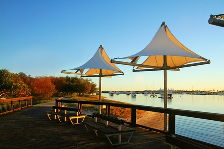 chillout: The Broadwater Gold Coast Australia seen through shade sails at Southport at dawn.