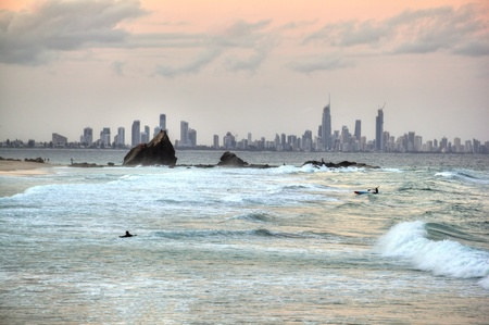 gold coast australia: Eerie view of Currumbin Rock looking towards Surfers Paradise on the Gold Coast Australia at a cloudy sunset. Stock Photo