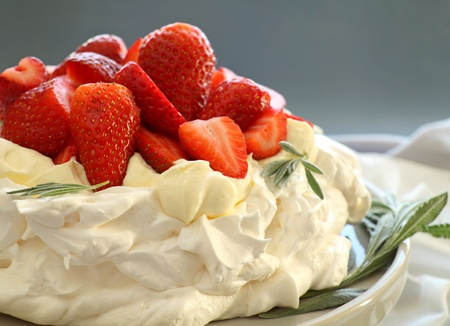 Delicious traditional Australian strawberry pavlova made from meringue and cream.