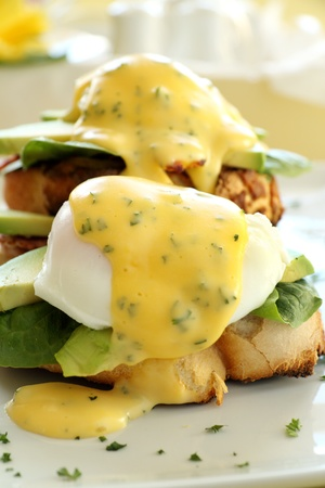 bacon and eggs: Beautiful eggs benedict with bacon and a rich hollandaise sauce on tiger crust bread.