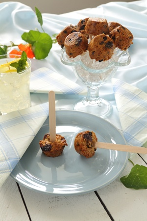 cake pops: Cute sweet muesli dessert baked in the shape of popsicles ready to serve. Stock Photo
