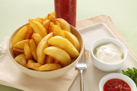 Potato wedges with sour cream and sweet chilli sauce.