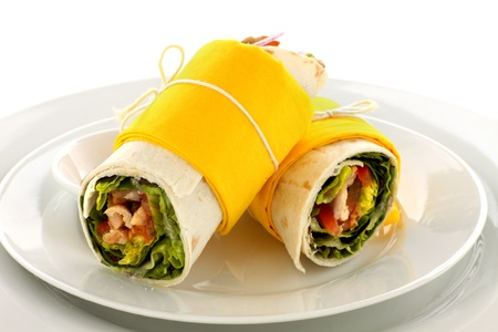 tortillas: Delicious spicy chicken wraps in tortillas ready to serve.