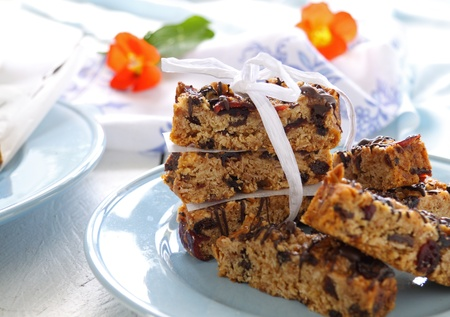Plate of homemade muesli bars wrapped with a bow. Stock Photo
