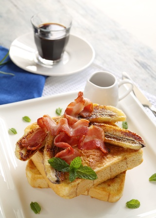 French toast with bacon and caramalized banana with maple syrup. photo