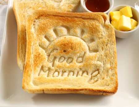 good morning: Slice of toast with Good Morning carved into it with butter and honey.