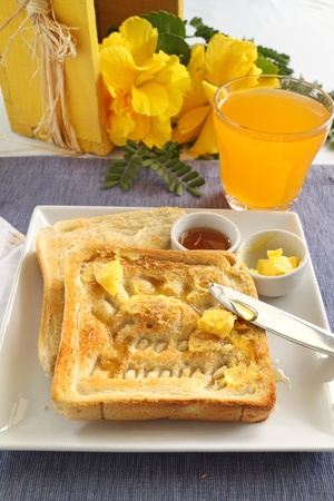 Slice of toast with Good Morning carved into it with butter and honey. Stock Photo - 12887194