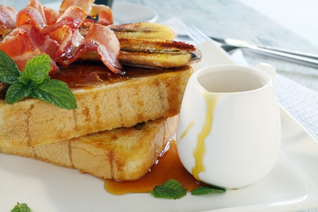 French toast with bacon and caramalized banana with maple syrup.