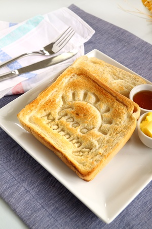 Slice of toast with Good Morning carved into it with butter and honey. Stock Photo - 13516748