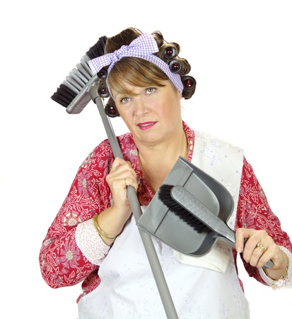 tedious: Middle aged frumpy house looks forlorn and exasperated holding a dust pan and broom.