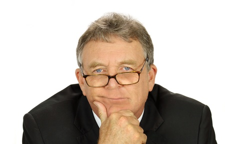 Perplexed middle aged businessman with glasses looking at camera. photo