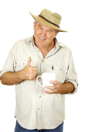 Casual middle aged man with coffee and hat gives the thumbs up. photo