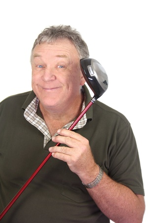 Middle aged man smiling holding his favourite golf club. photo