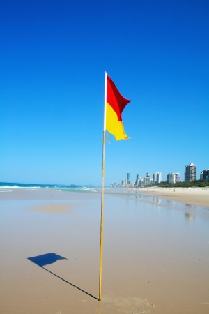lifesaving: Swimming safety flag on the Gold Coast Northern beach looking towards Surfers Paradise
