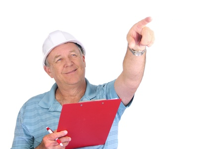 foremaster: Middle aged construction foreman with hard hat pointing and smiling.