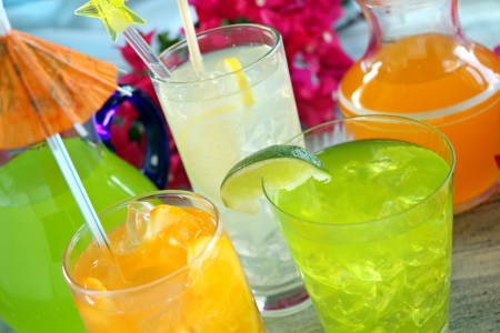 A selection of summer drinks with ice including lime, orange and lemon. photo