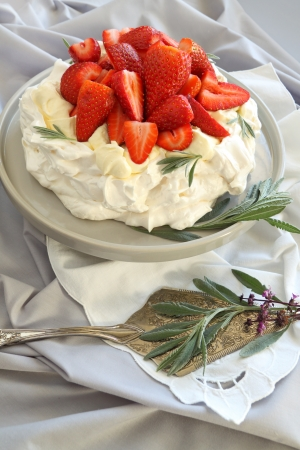 Delicious traditional Australian strawberry pavlova made from meringue and cream. photo