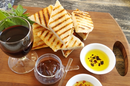 dips: A selection of Italian finger food with grilled brushetta and dips with olive oil and chillies.