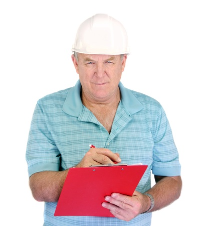 foremaster: Middle aged construction foreman takes notes on his clipboard.
