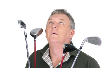 Middle aged golfer looking toward the heavens praying for his next shot. photo