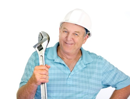 Middle aged construction worker with a large wrench  photo