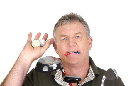 Middle aged golf player holding two used golf balls with tees in mouth  photo