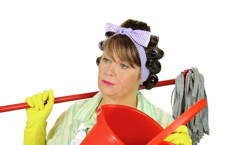 drab: Frumpy unhappy middle aged housewife with a mop and bucket. Stock Photo