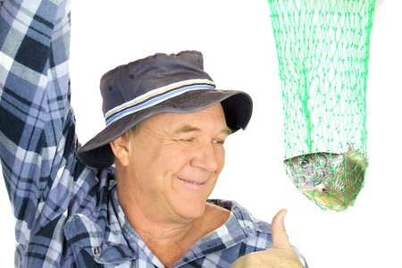 catch up: Proud fisherman holds his catch up in a net with a thumbs up.