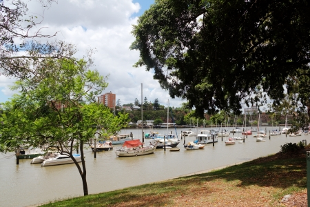 grassy knoll: Boats and yachts moored in the Brisbane River by the Brisbane City Botanical Gardens in Queensland Australia. Stock Photo