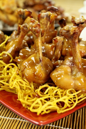 flavorful: Delicious Chinese chicken drumettes on a bed of noodles.