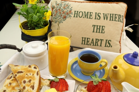 Breakfast with tea, orange juice, toast and muesli ready to serve. Stock Photo - 17930173
