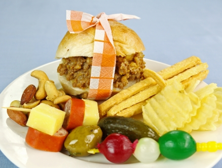 flavorful: Mini slider beef burger with assorted finger food and nuts.