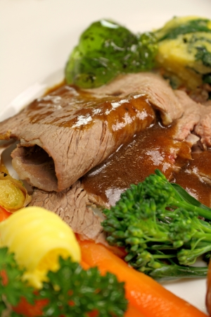 Delicious sliced roast lamb with baked vegetables and mint jelly. Stock Photo - 17930159