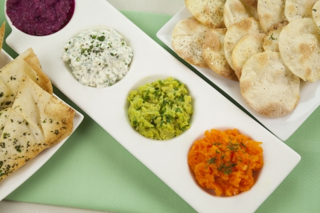 dips: Assorted dips of carrot, cottage cheese and herbs, pea and basil with pita crisps.