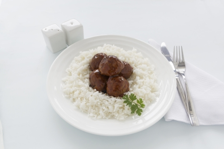 hoisin: Chinese meat balls in hoisin sauce on a bed of white rice with parsley.