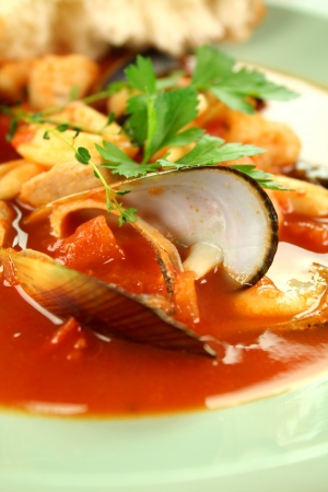 seafood soup: Delicious Mediterranean style tomato seafood soup with mussels and mixed seafood.