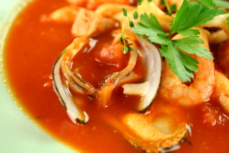 seafood soup: Delicious Mediterranean style tomato seafood soup with mussels and mixed seafood