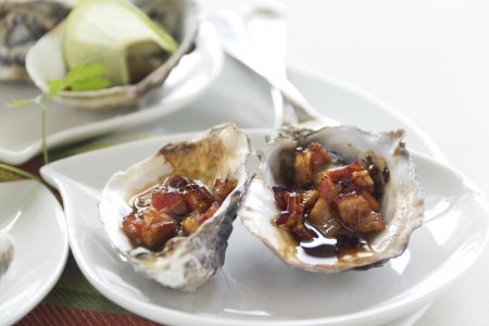 worcestershire: Delicious oysters kilpatrick with bacon and worcestershire sauce ready to serve.