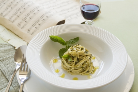 Delicious spaghetti with pesto with red wine ready to serve. photo