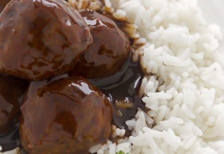 hoisin sauce: Chinese meat balls in hoisin sauce on a bed of white rice with parsley.